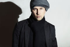 Fashionable Handsome Man in Black scarf.Stylish Boy in hat.Young man.spring casual fashion. Fashionable Handsome Man in Black scarf.Stylish European Boy in hat Stock Images