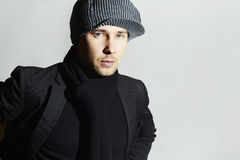 Fashionable Handsome Man in Black scarf.Stylish Boy in hat.Young man.spring fashion Royalty Free Stock Images