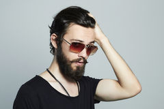 Fashionable handsome man. Brutal bearded Sexy boy in trendy sunglasses Royalty Free Stock Photo
