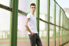 Fashionable handsome man model posing outdoors royalty free stock photo