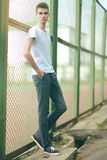 Fashionable handsome man model posing outdoors stock photo