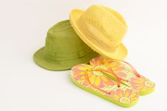 Fashionable hats with flip-flops. On white background royalty free stock photos
