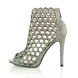 Fashionable High Heels ankle boots, XXXL image. High heels ankle boots for spring and summer, in silver mesh design, XXL image Royalty Free Stock Photo