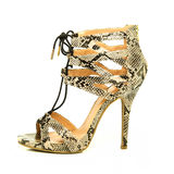 Fashionable High Heels Shoes with animal print design. Fashionable strappy high heels shoes with small platform sole and ankle straps, animal print design,  XXL Royalty Free Stock Images