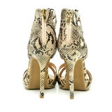 Fashionable High Heels Shoes with animal print design. Fashionable strappy high heels shoes with small platform sole and ankle straps, animal print design,  XXL Stock Image