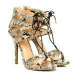 Fashionable High Heels Shoes with animal print design. Fashionable strappy high heels shoes with small platform sole and ankle straps, animal print design,  XXL Stock Images