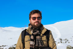 Fashionable hiking man with beard and sunglasses Stock Photography