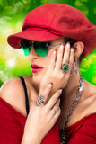 Fashionable Hip Hop Woman. Beauty Party Girl. Portrait of beauty brunette with red cap and glasses Stock Photography