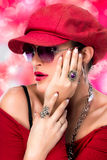 Fashionable Hiphop Girl. Beauty Brunette with Red Cap. Portrait of fashionable hiphop girl with red cap and glasses Stock Images