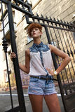 Fashionable hipster girl posing Royalty Free Stock Image