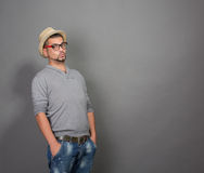 Fashionable hipster man in studio Royalty Free Stock Images
