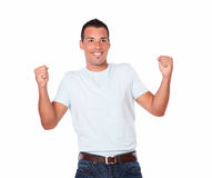 Fashionable hispanic man celebrating his victory Royalty Free Stock Photo
