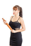 Fashionable housewife holding rolling pin Royalty Free Stock Image