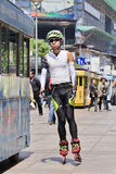 Fashionable inline skater in a shopping street, Shanghai, China stock photos
