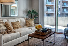 Fashionable interior of exclusive townhome apartments. Living room of exclusive downtown town home patio luxury apartments stock images