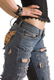 Fashionable jeans. The girl in fashionable jeans with holes Royalty Free Stock Image