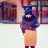 Fashionable kid, boy on shopping in winter season Royalty Free Stock Images