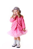 Fashionable kid with lipstick on white Royalty Free Stock Images