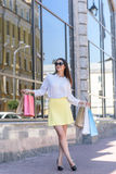 Fashionable lady buying things in town Royalty Free Stock Image