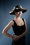 Fashionable lady with hat Stock Images