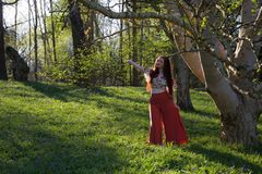 Fashionable lady posing by a silver birch tree royalty free stock photos