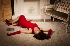 Fashionable lady in a red dress lying on the floor Stock Images