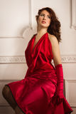 Fashionable lady in a red dress Stock Photos