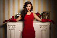 Fashionable lady in a red dress Royalty Free Stock Photo