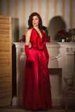 Fashionable lady in a red dress Stock Photo