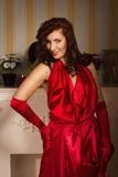 Fashionable lady in a red dress Royalty Free Stock Photography