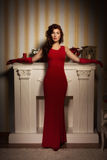 Fashionable lady in a red dress Royalty Free Stock Images