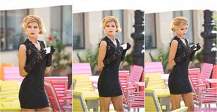 Fashionable  lady with short black lace dress and red scarf  and high heels, outdoor shot . Young attractive short haired blonde. Woman with sunglasses posing Stock Image
