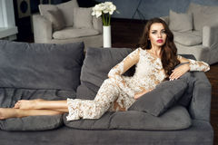 Fashionable lady in stylish interior Stock Photo