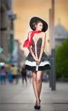 Fashionable lady wearing black hat posing on the street Royalty Free Stock Image