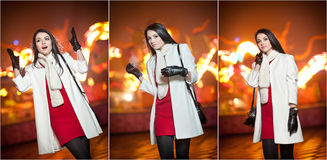 Fashionable lady wearing red dress and white coat outdoor in urban scenery with city lights in background. Full length portrait Royalty Free Stock Image