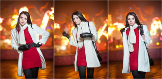 Fashionable lady wearing red dress and white coat outdoor in urban scenery with city lights in background. Full length portrait Stock Photography
