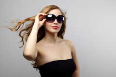 Fashionable lady wearing sunglasses Royalty Free Stock Image