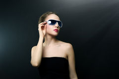 Fashionable lady wearing sunglasses Royalty Free Stock Photography