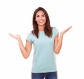 Fashionable latin girl holding her palms up Royalty Free Stock Photo
