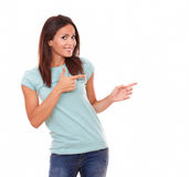 Fashionable latin lady pointing to her left Stock Photos