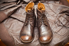 Fashionable leather boots and leather jacket. Vintage style. Cowboy style royalty free stock images