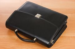 Fashionable leather briefcase on a table Stock Photo