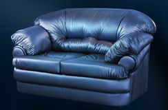 Fashionable leather sofa on a black background. Fashionable black leather sofa on a black background Stock Photos