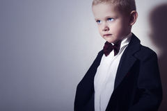 Fashionable Little Boy in Bow tie.Stylish kid. fashion children. 4 Years Old Child in Black Suit Royalty Free Stock Photography