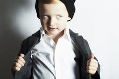Fashionable little boy in cap.stylish kid. fashion children. Royalty Free Stock Image