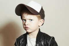 Fashionable little boy.fashion children.Boy in Tracker Hat.Sad Child in Cap Stock Photography