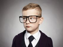 Funny child in suit and glasses Royalty Free Stock Images