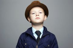 Fashionable little boy in hat. kid in tie, business child Stock Photography