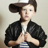 Fashionable little boy.Hip-Hop Style. fashion chil. Dren.handsome blond kid with big blue eyes. Boy in Tracker Hat. Young Raper. Funny Child in Cap. 4 years old stock photography