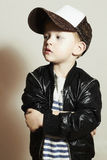 Fashionable little boy.Hip-Hop Style. fashion children. Handsome blond kid with big blue eyes.Pose Boy in Tracker Hat. Young Rapper. Funny Child in Cap. 4 years Stock Images